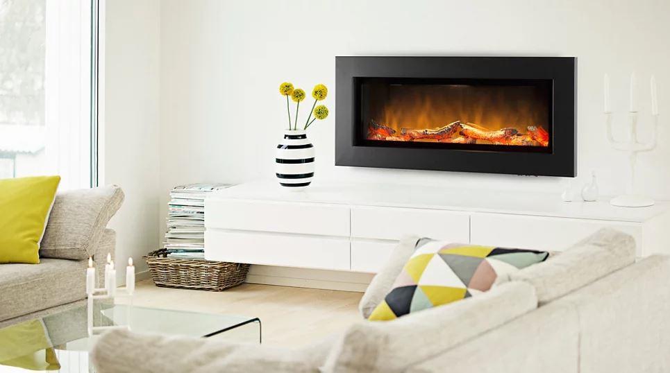 Chimenea eléctrica insertable en acero negro con tecnología led, muy realista que incluye troncos decorativos que simulan la madera mientras se quema en una chimenea de leña